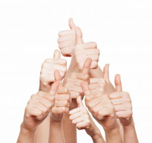 hand of business group with thumbs up